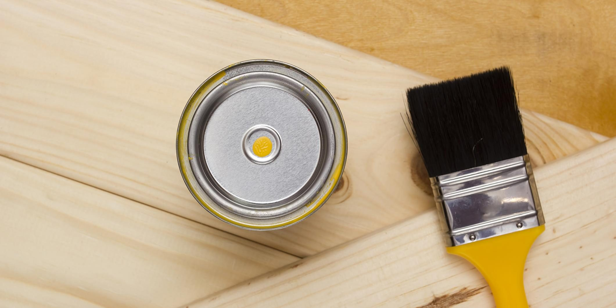 a can of paint and a brush