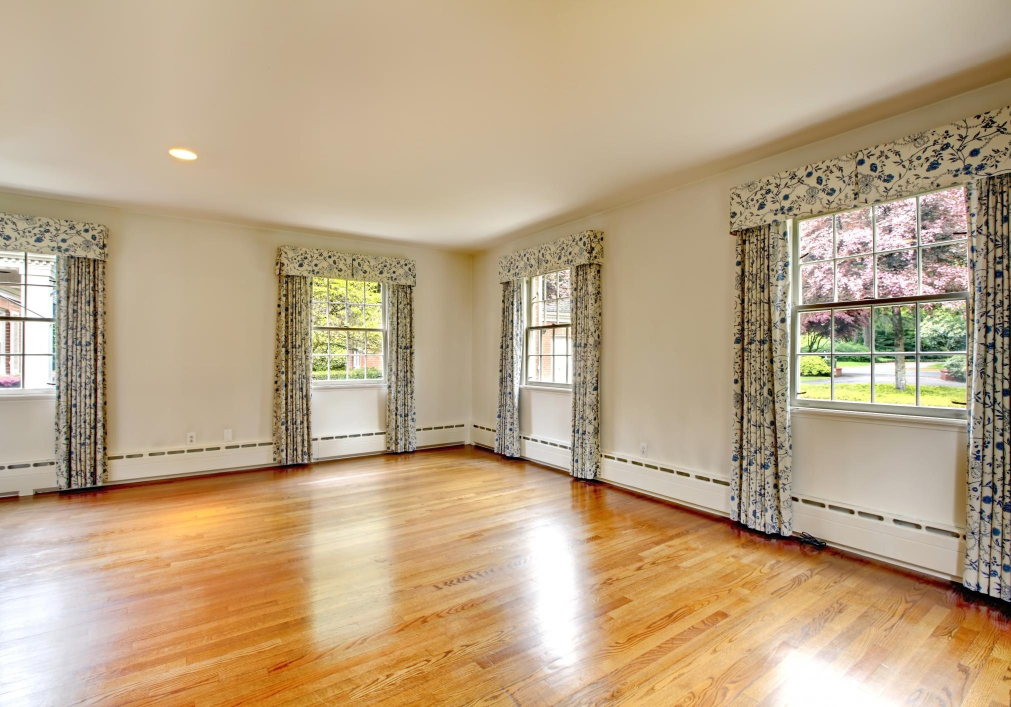 an empty house room with floral curtains