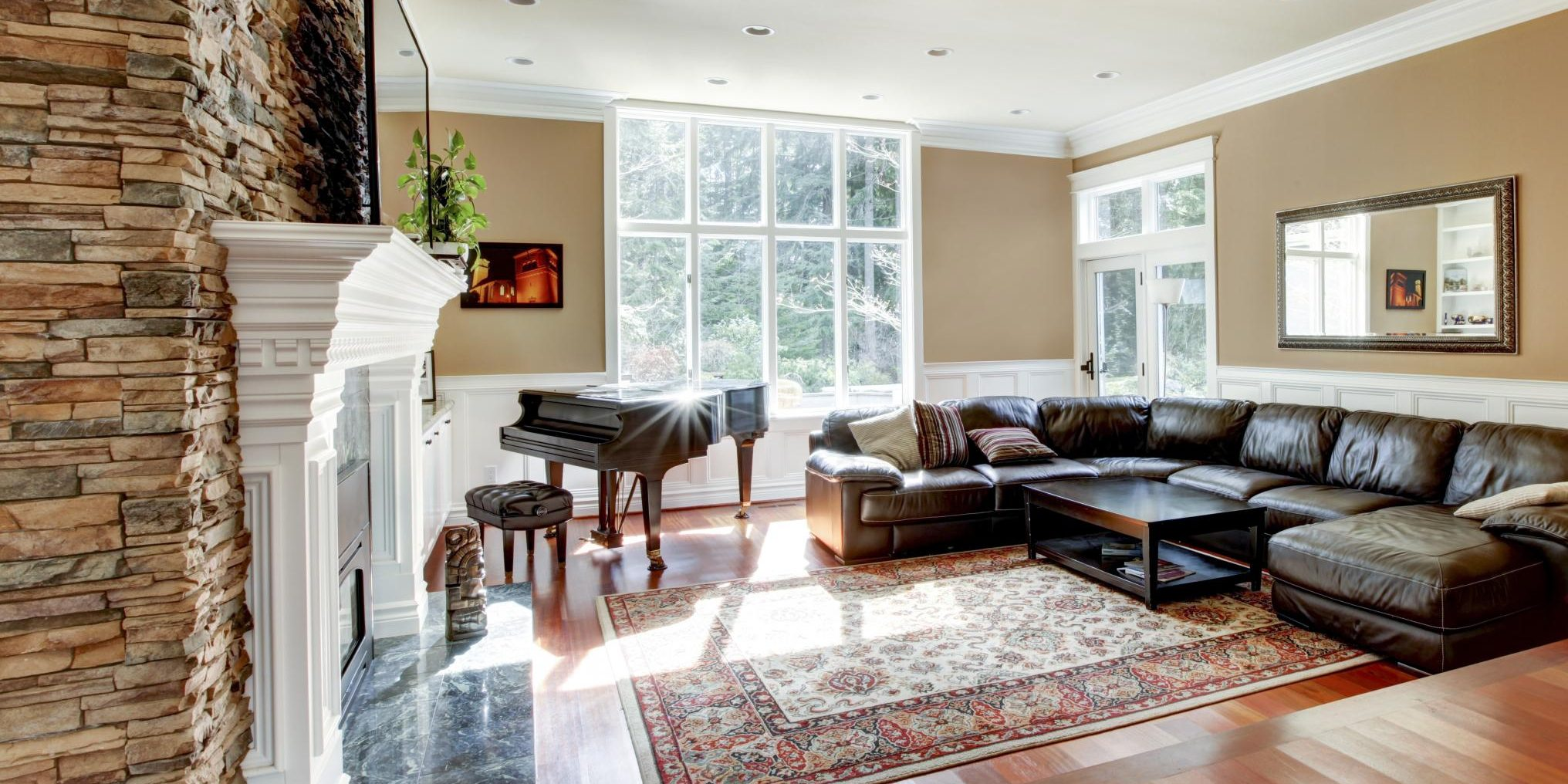 a living room with carpet and sofa