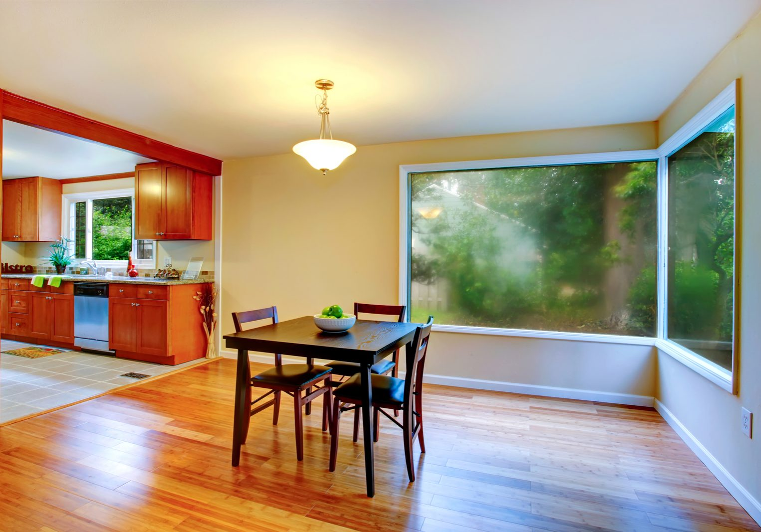 a dining area with wood flooring