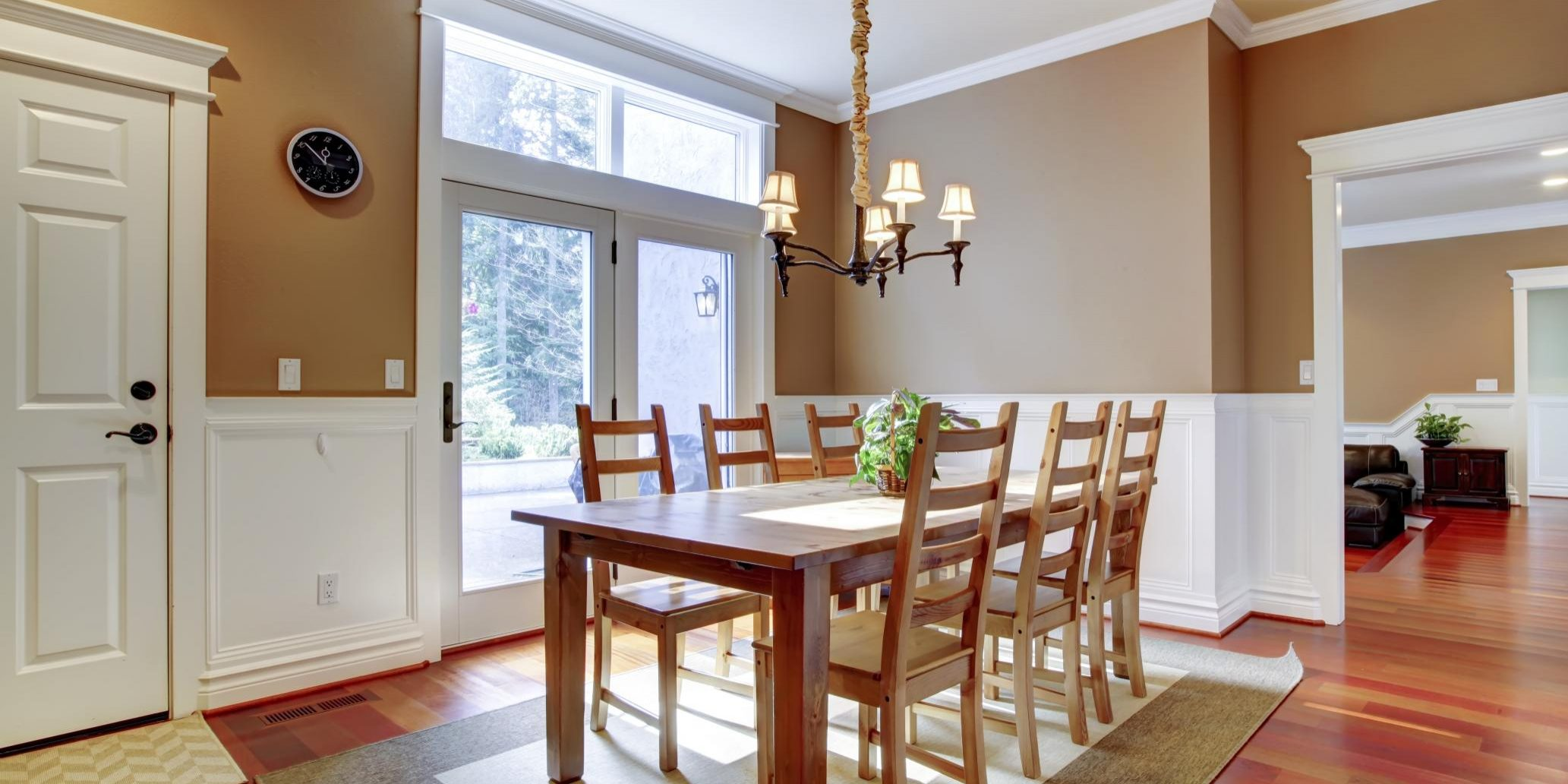 a wood dining table and chairs